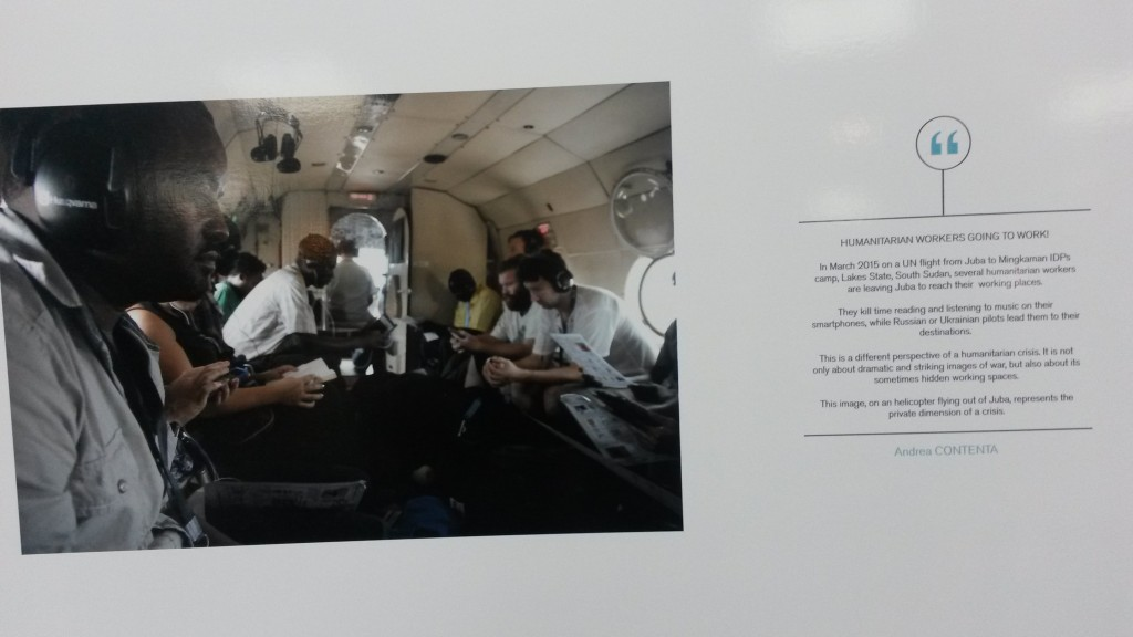A photo on display at the conference: humanitarian workers on their way by helicopter to an IDP camp in South Sudan (Andrea Contenta)